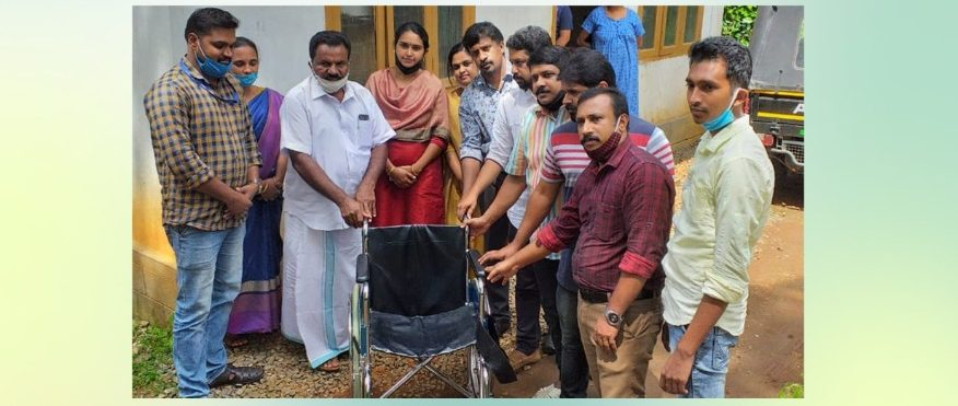 Friends of Kattappana handing over wheelchair to Kanchiyar Grama panchayat president VR Sasi, for the benefit of a differently abled student.